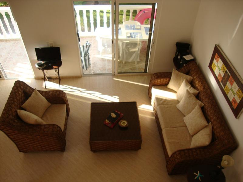 The air-conditioned living area opens to the terrace. DVD player and flat screen, CD player for iPod.