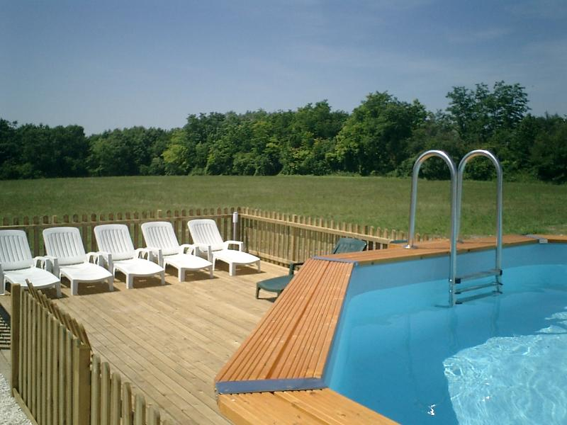 Decked sunbathing area by the pool