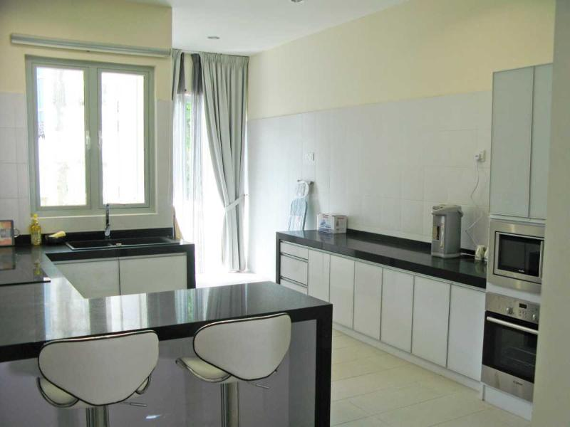 The kitchen installed with conventional & microwave ovens, fridge, induction cooker, etc.