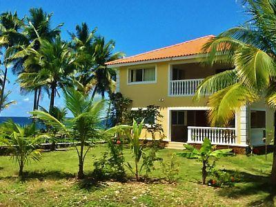 The villa is located in a gated community and has a private beach.