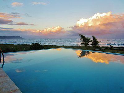Watch the sun or the moonrise from the infinity pool.