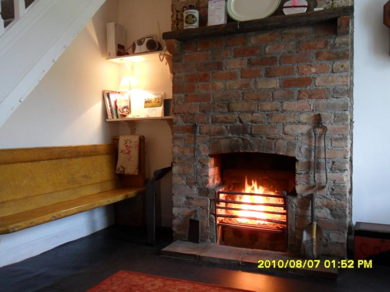 The living/dining room with large open fire, perfect for cosy nights in