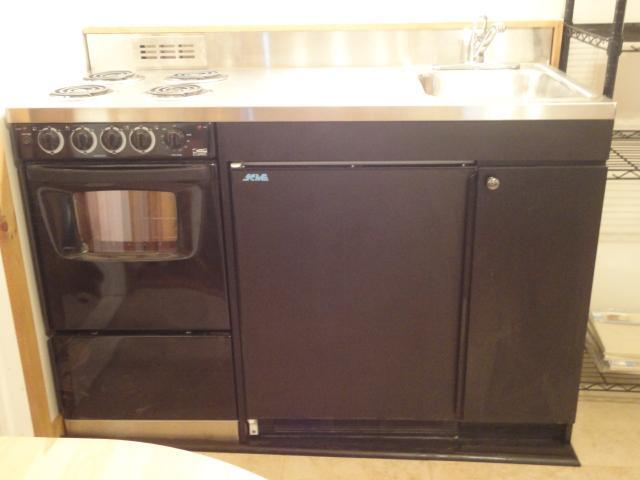 4 burners, small oven, 1/2 refrigerator , stainless top
