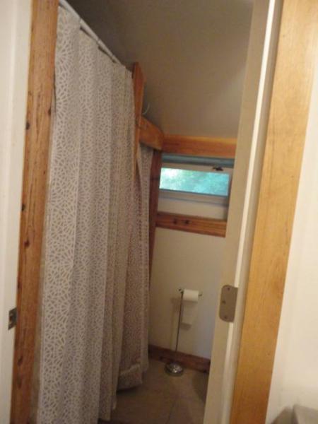 Door into tiled bathroom