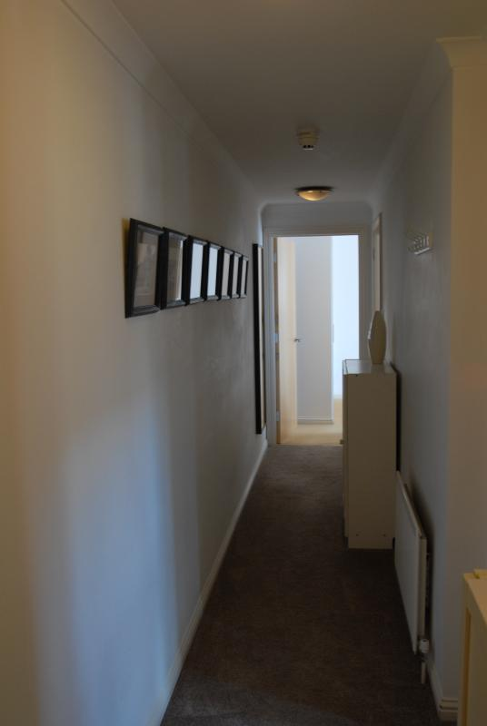 Hallway and Gallery of Old Photos of Inverness (Looking towards bedroom).