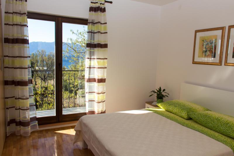 Double bedroom with terrace overlooking garden and sea views