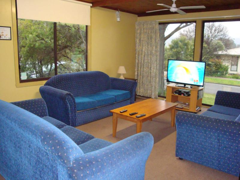 Roomy lounge room with seating for 10 has picture windows with views down the Kiewa Valley