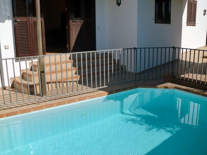 Private heated pool, with child friendly safety fence.
