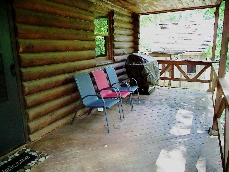 Covered Back Porch overlooks Woods and trail leads down to the River Bank (it is a bit steep)