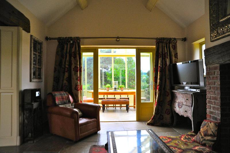 Sitting Area with double doors opening up to Orangery