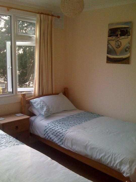 Twin bedroom, with wardrobe and chest of drawers.