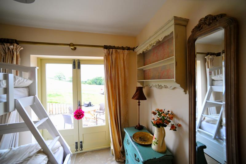 Second Bedroom with doors opening onto patio
