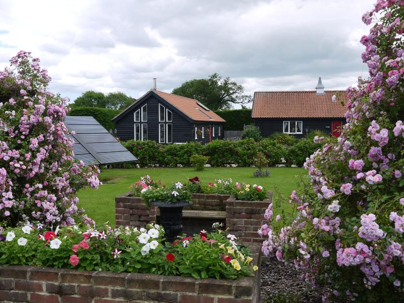 View of the cottages through the rose covered pergola