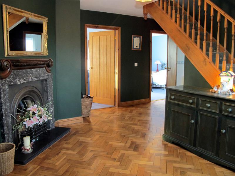 Halway with wood flooring