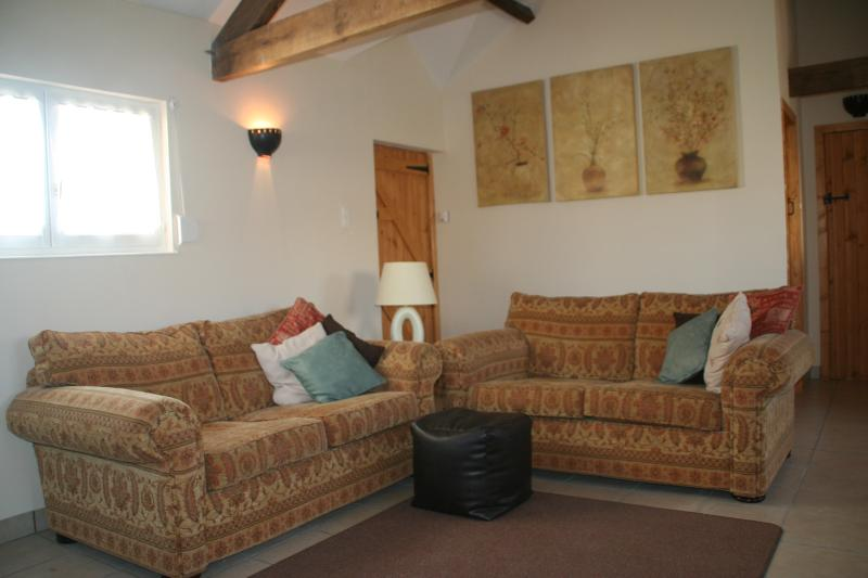 Lounge Area with comfortable large sofas, freeview TV, DVD CD & ipod docking station