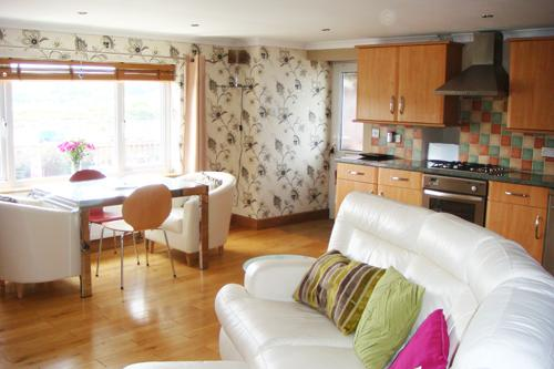 Lounge, kitchen, diner open plan with large picture window over looking harbour