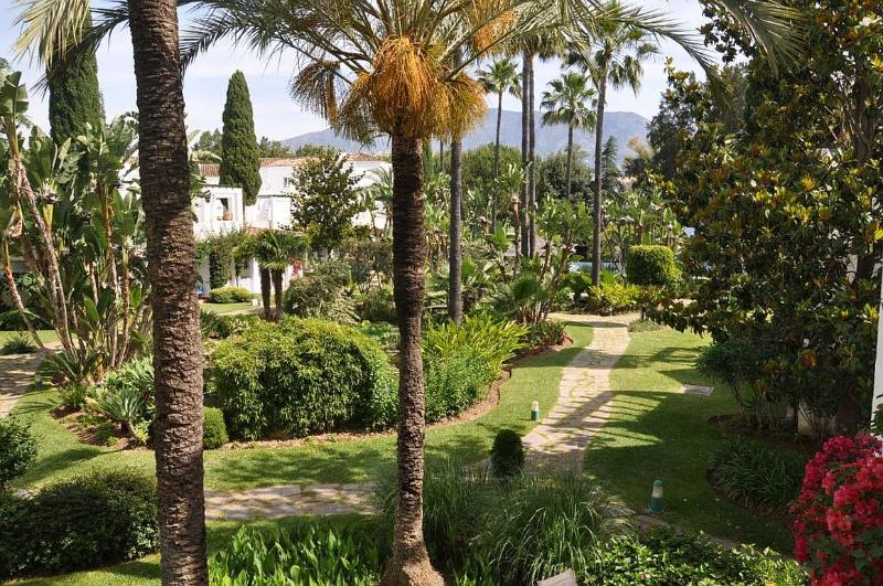 The townhouse is set in extensive tropical gardens