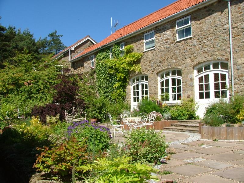 The landscaped central courtyard is filled with herbs and fragrant flowers