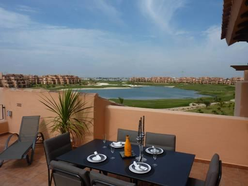 Stunning views from our  large  roof terrace of lake, golf course, swimming pool & mountains