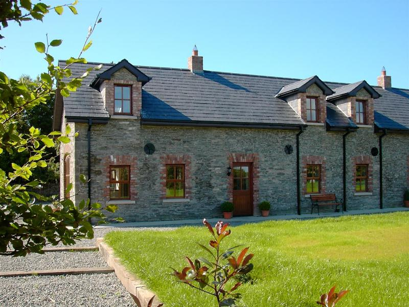 beautiful stone cottages overlooking pretty gardens