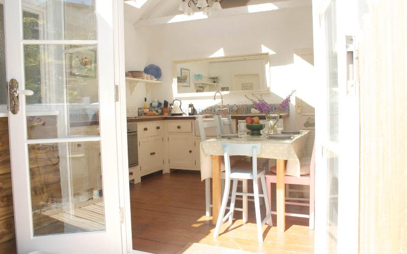 Beautiful light farmhouse kitchen leading onto the garden