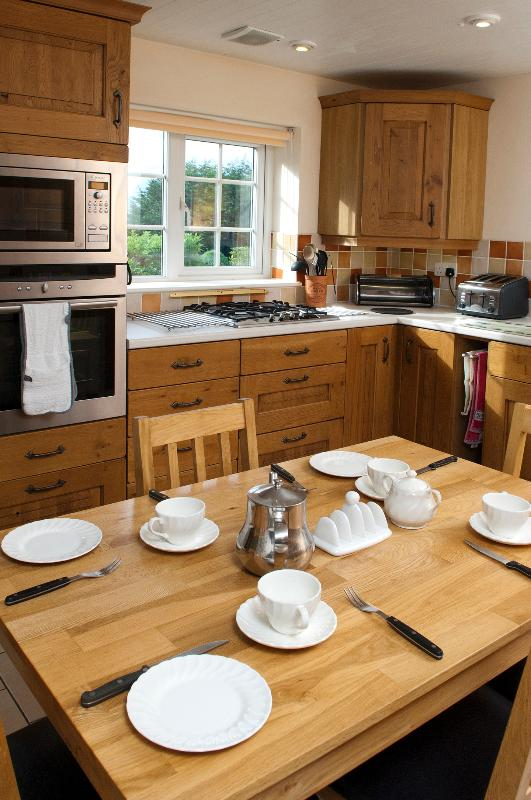 Large Kitchen with dining table and sea views