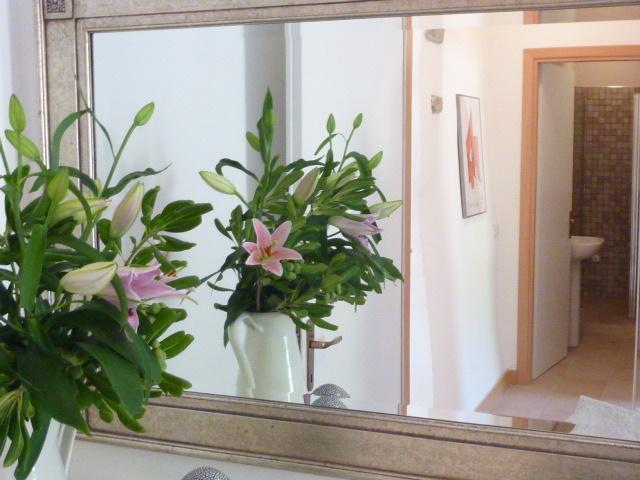 Family bathroom with large walk-in shower is just off the lobby between the two bedrooms