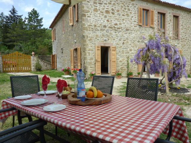 'Al Fresco' lunch on the garden table just a few steps from the apartment doors