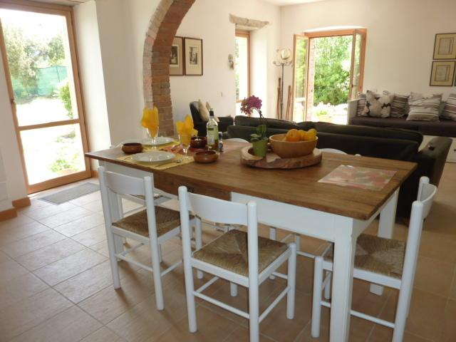 Spacious living and dining areas open straight onto the garden with ample sunlight through the day