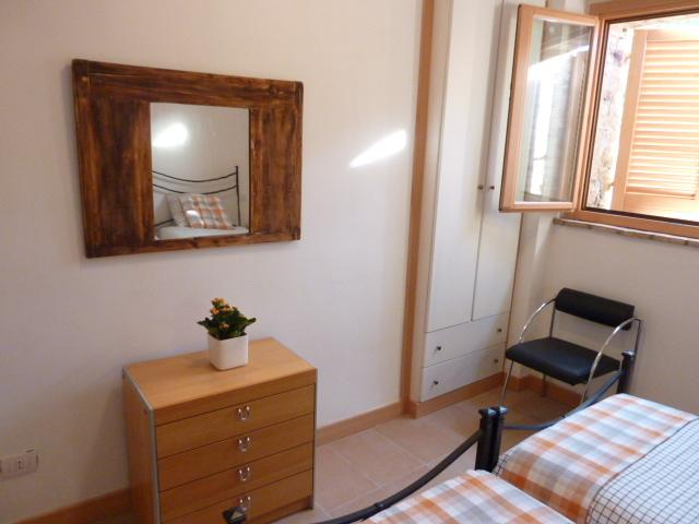 Dressing mirror and fitted wardrobe in the twin room