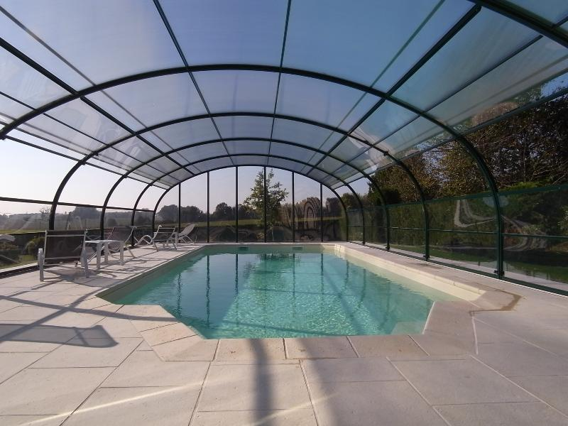 Heated swimming pool in terraced garden room