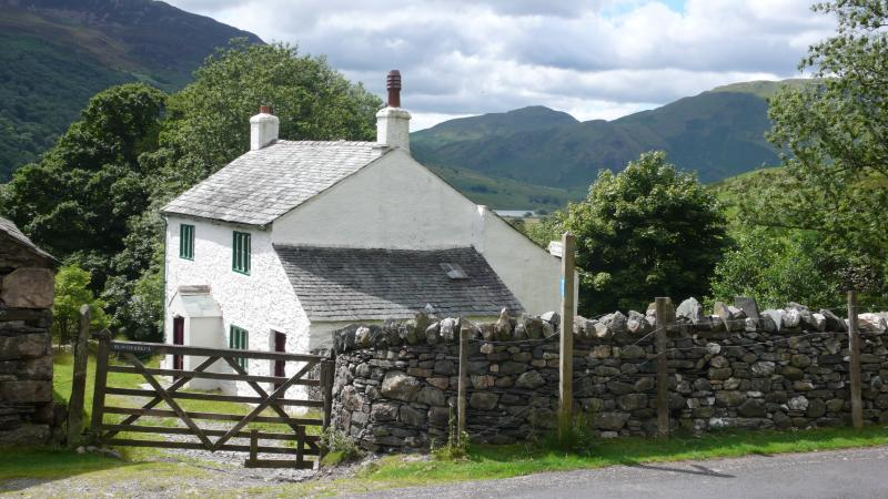 Bowderbeck cottage with Crummock Water and the mountains behind