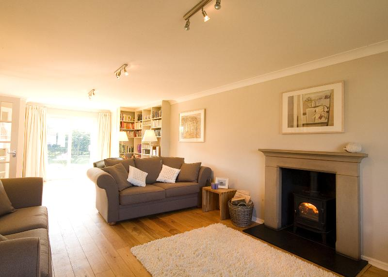 Plenty of space in the huge, comfy living room with woodburner