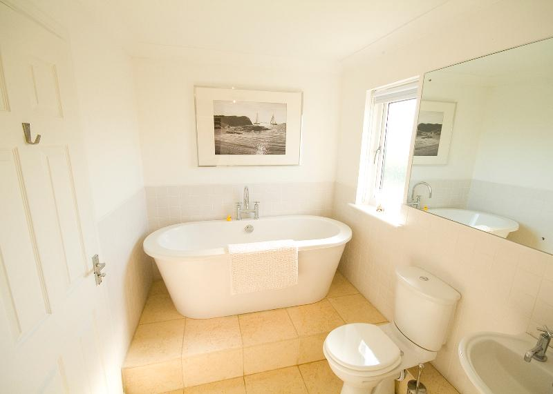 A larger view of the luxury family bathroom with bath and shower