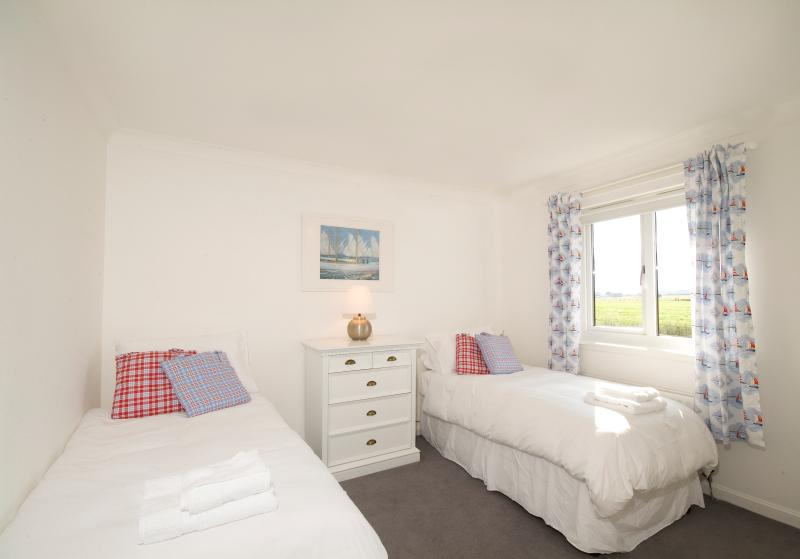 One of the warm, bright, twin-bedded rooms with views to Bamburgh Castle