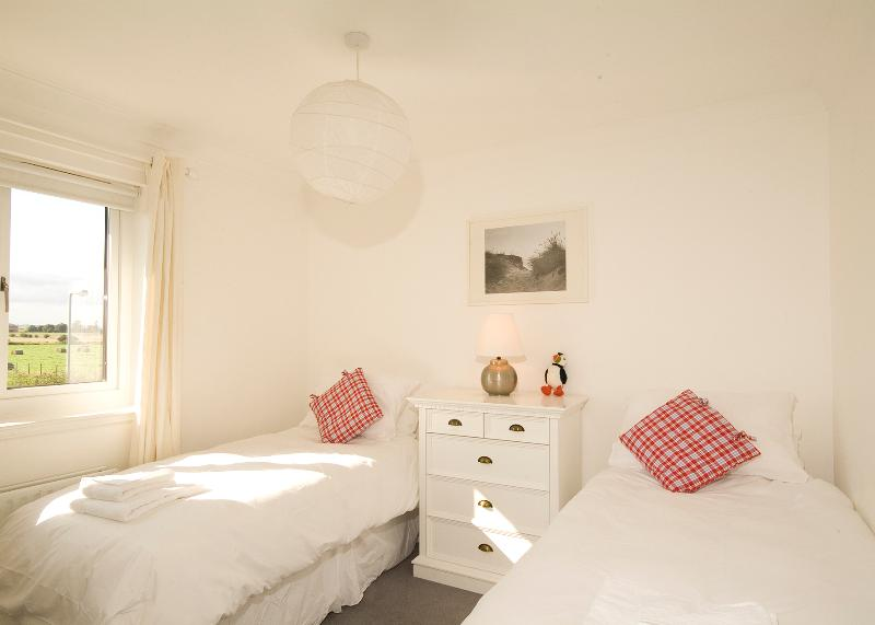 The cosy second twin bedroom with views to Bamburgh Castle