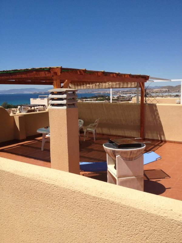 Private Solarium with table/chairs and pergola with bbq