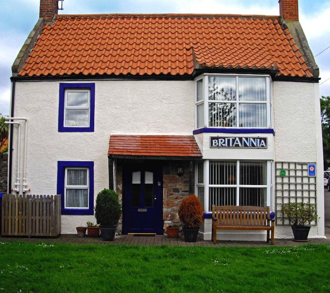 Centrally located with views across the village green