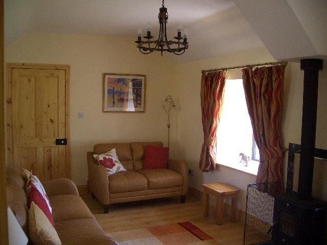 Cosy sitting room with wood burning stove & views of the countryside