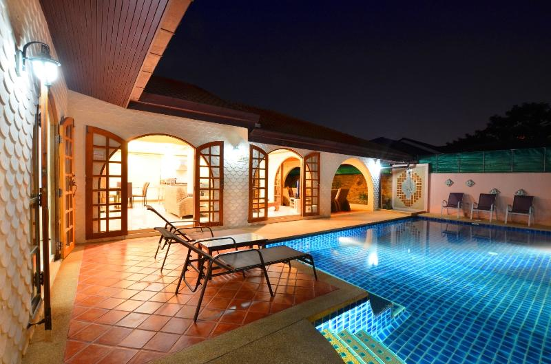 evening photo of pool and villa.