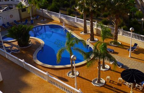 Large heated pool viewed from apartment balcony