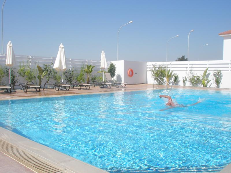 Secure gated pool with garden sun loungers and full facilities for those with restricted mobility