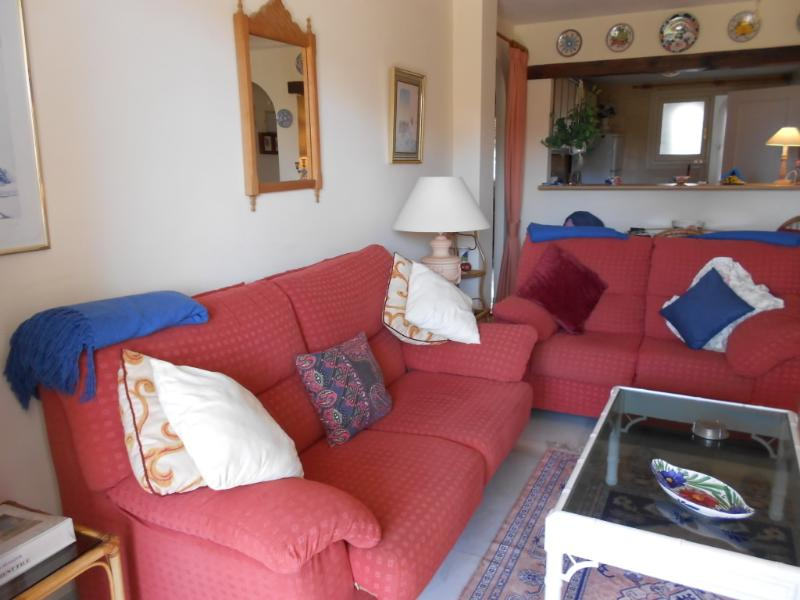 comfortable sofa and coffee table. Opens to sunny glass windows sun lounge. fully opens in summer.
