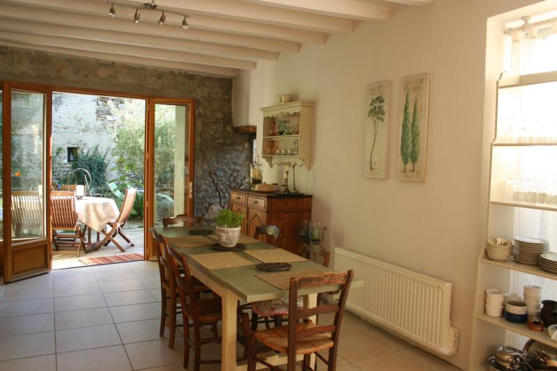 Dining room and kitchen, the airy heart of the house.