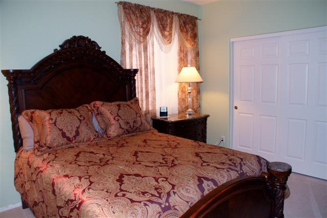 Queen bedroom downstairs with its own full bathroom