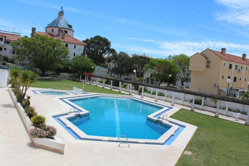 Shared swimming pool with nice garden around