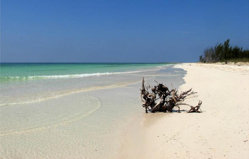 The beautiful white sand beach is about 3-minutes walk away