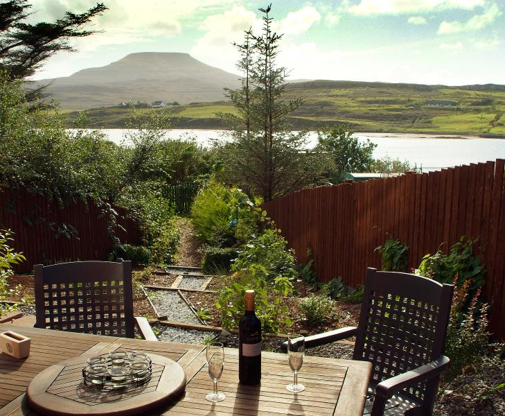 View of back garden accross to Macleod's Tables from kitchen window