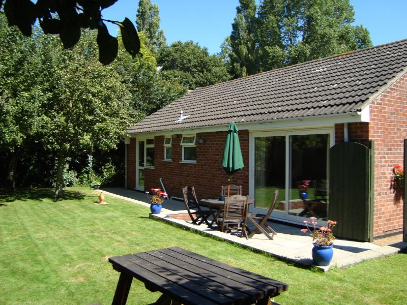 Secluded rear garden with mature fruit trees ,barbecue and wildlife corner with pond.