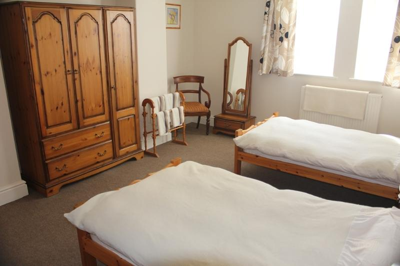 Second bedroom with twin beds, dressing table, wardrobe